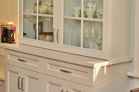 China cabinets with bead-board backs and painted counter tops. Glass shelves. Two-stage crown molding tops